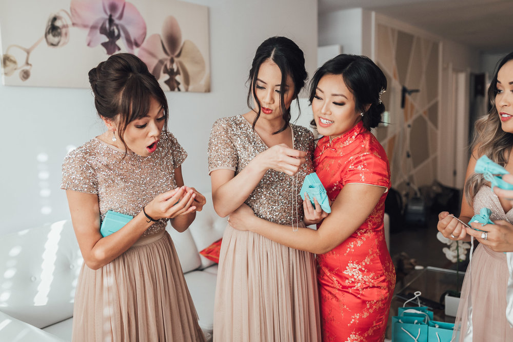 bride giving gifts to bridesmaids candid vancouver wedding photography