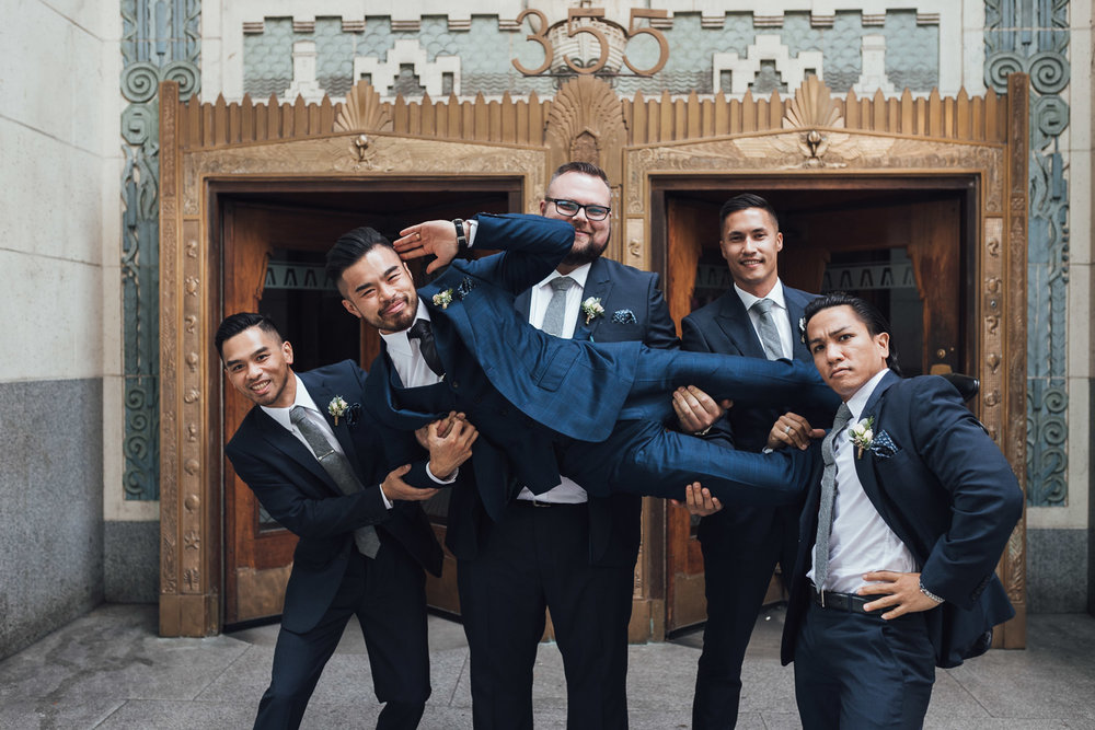 marine building groomsmen portrait vancouver wedding photography