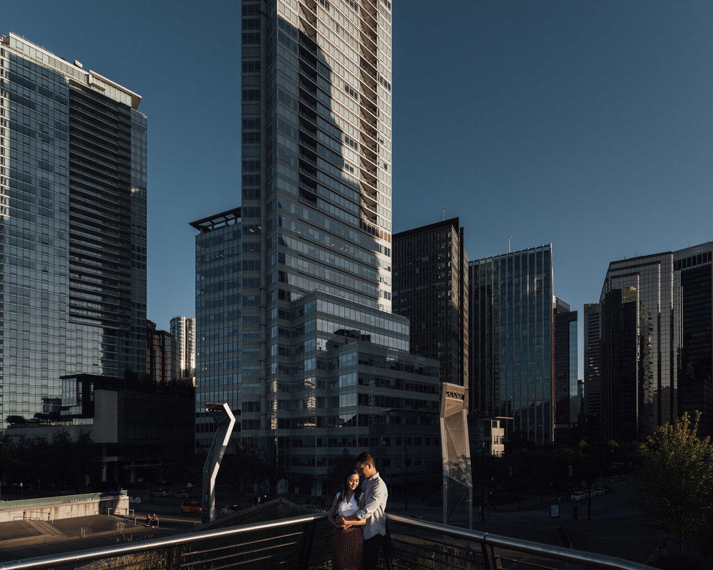 coal harbour engagement photography in vancouver bc during sunset marine building