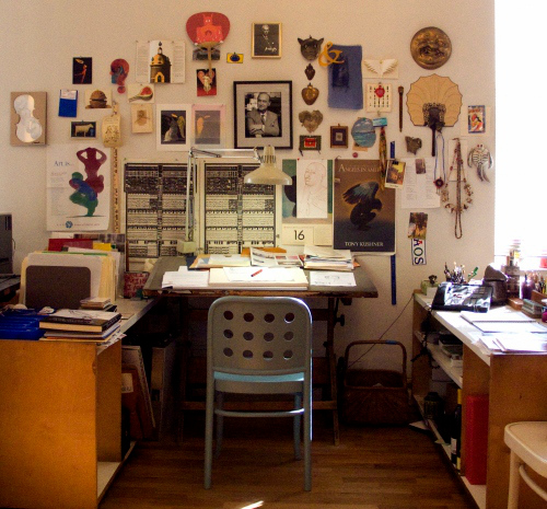 Desk of Milton Glaser, graphic designer. I love all the items on the wall.