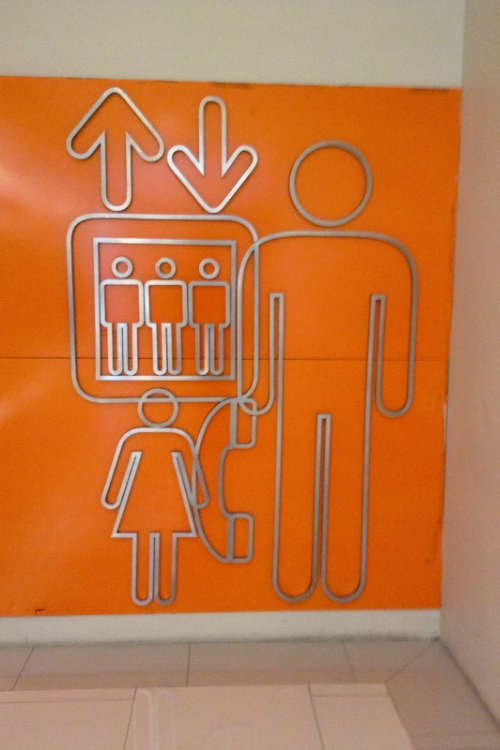 Since this is sort of a random items post, I thought I'd include this photo. I took this in a Bangkok mall. Is this not the worst design of a bathroom sign that you have ever seen? Why is the woman so small? Why is she being crushed by the elevator? Why why why?