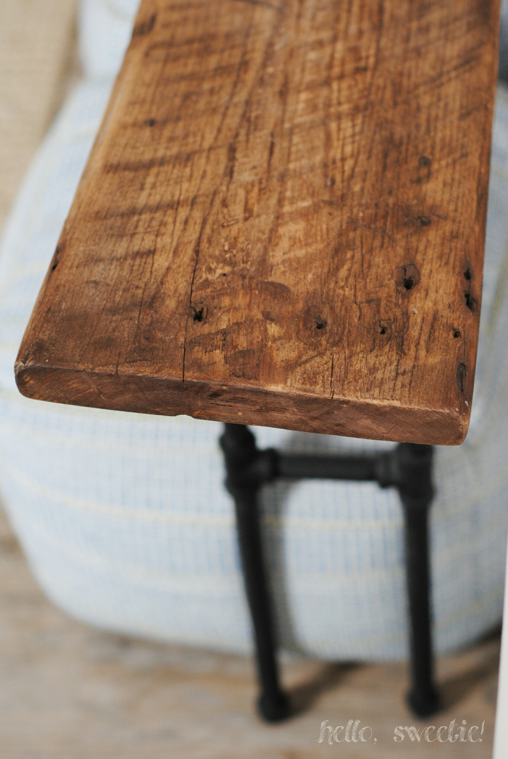 a console table we built from reclaimed barnwood and plumber's pipe