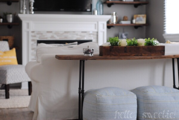 poufs are stored under the console table until movie time, then we bring them forward and prop up our feet or sit on them for game night.