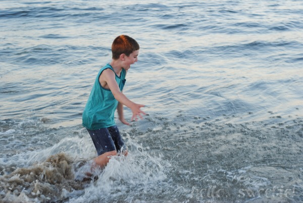 Our oldest son, experiencing the ocean for the first time. Seeing the joy on his face was worth the wet & sandy backseat afterward, on the ride back to the condo.