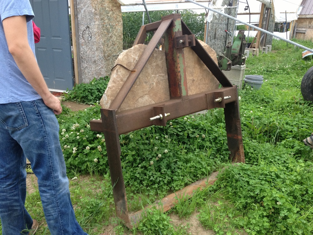 This is a nifty tool that the farm's mechanic Ryan made; it runs through a bed of carrots behind a tractor, lifting them up from below to loosen them, making harvest a breeze.