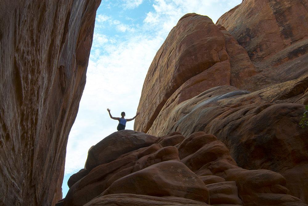 Climbing high near Sand Dune Arch