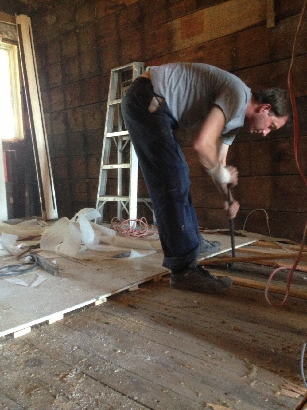 Removing the laminate flooring - exposing original wood floors!