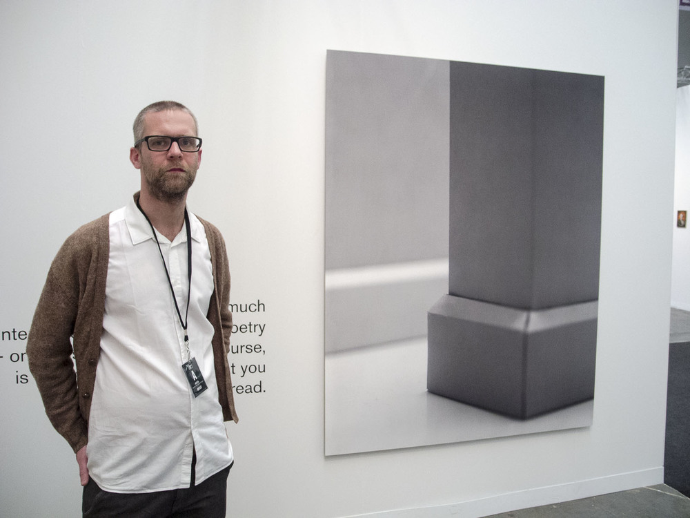 Denes Farkas in front of his piece at the Armory Show in the Molnar Ani Gallery space