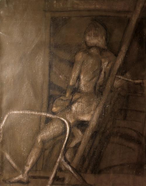 A woman, sitting