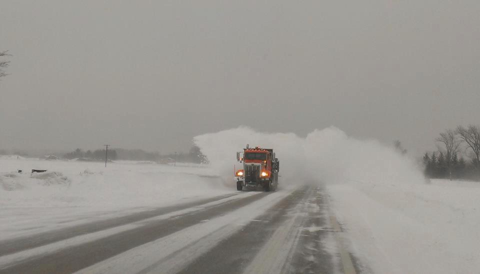A Leelanau County Road Commission snowplow clears the roads.