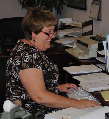 Lori hard at work wearing her glowing smile!