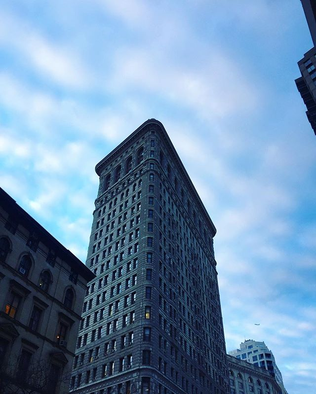 Still light out when leaving work = the best.  #springishere #flatiron #blueskies #architecture #nyc