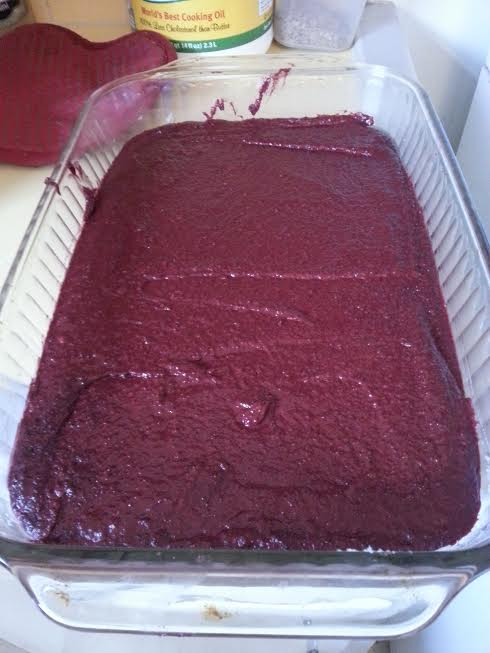 This is what the batter looks like before baking, a beautiful red velvet color!  It will turn brown and look like delicious chocolatey goodness after baking :)