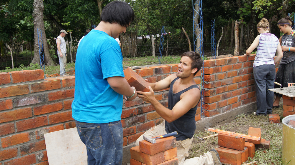 Benjamin Reese, involved with G.O.D. International since 2009, works with a SLAM student to build a house in rural El Salvador.