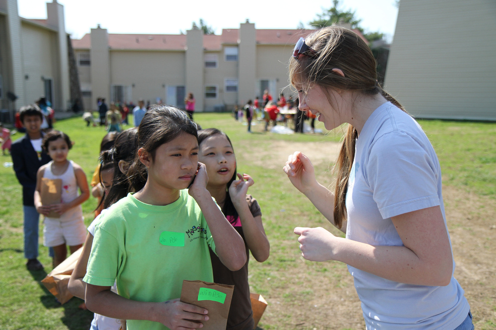Megan Matthews, involved with G.O.D. Int'l since 2007, facilitates a service project at an apartment complex largely populated by refugees.