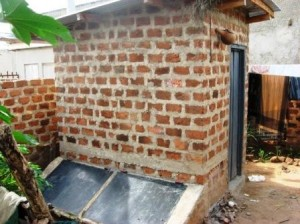 This is a view of the eco-toilet from the back and side. The structure was constructed with local materials.