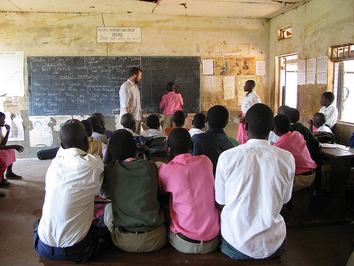 In this crowded Ugandan classroom where Corey Streeter taught English, only one skirt is visible.  The WHO says that 20% of female students in East Africa will drop out before secondary school.