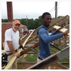 Scott Sherrod and Steven Chigumira work together on the construction of the pavilion. While Music City Handyman donated a lot of time through their skilled labor, several other volunteers also helped, learning skills through working together.