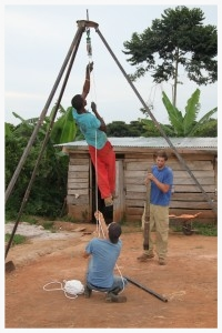 Josh Kurtz and Ugandan Cooperative Peter Kimbugwe designed and constructed this tripod structure for lowering and bringing up loose parts out of dysfunctional wells. Though Kurtz was the individual originally trained in well repair, he passed on his knowledge to six other African men who are now empowered to repair them, even when Kurtz is not present.