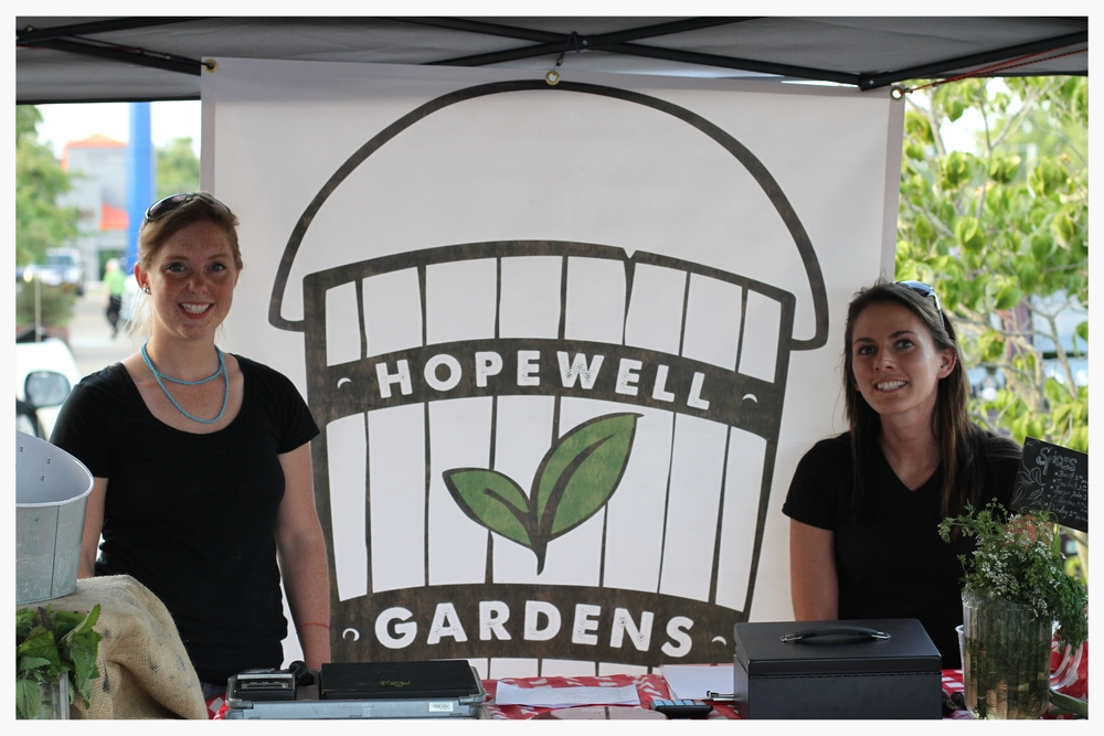 Breann Bennecker (left) and Rachel Webb (right) are forming relationships with the local community through their weekly stand at the Donelson Farmer's Market.