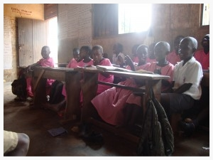 Classroom conditions in the government school where Ssemakula teaches are poor, with no noise control from the classroom next door (no ceiling or walls that go to the roof), and a 40:1 student to teacher ratio.