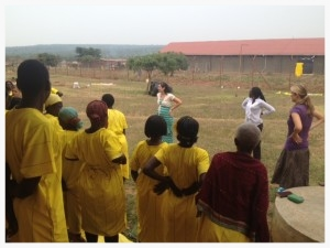 Kim was able to teach stretching, body positioning, and give massage therapy at a woman's prison in rural Uganda. Here, the women learn the benefits of good posture, and practice it together.