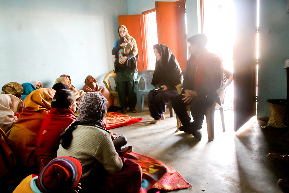 Rosemary teaches a group of believers in a remote area.