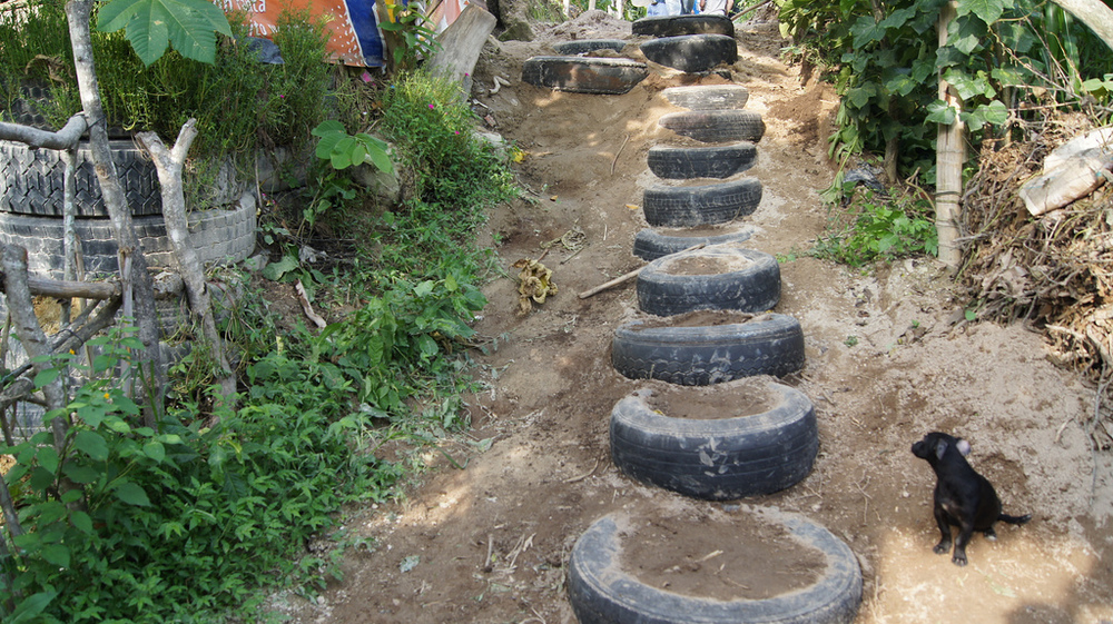 These simple stair steps made from salvaged tires improve the structure of the eroded hillside and make safer passage for those walking through.