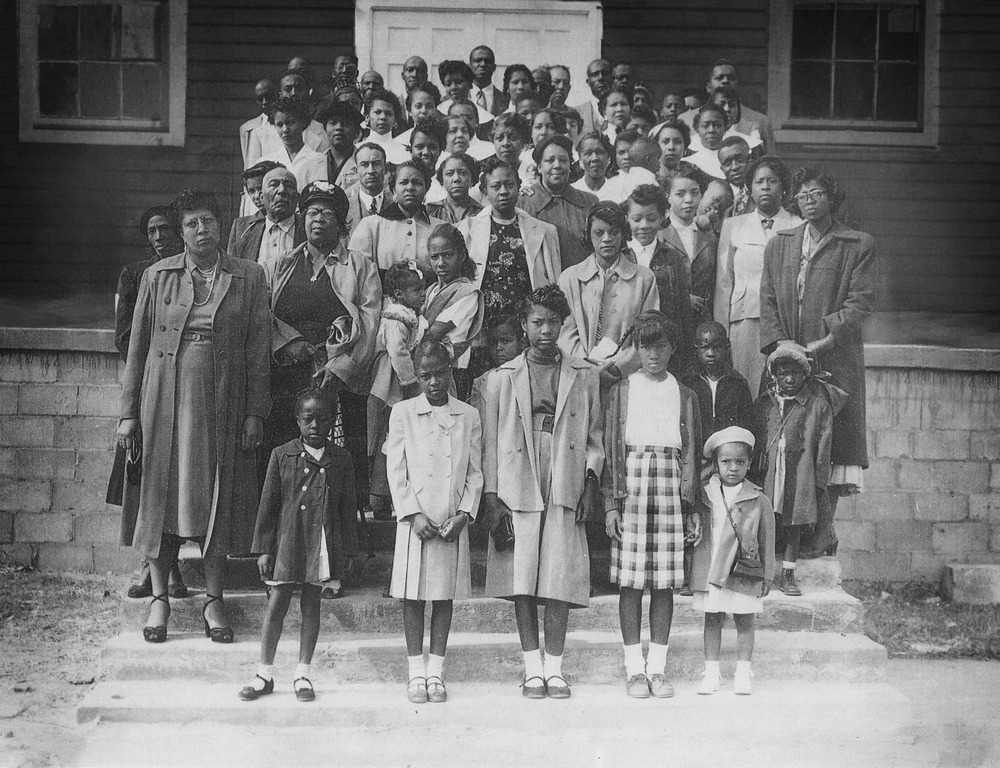 In 1947, congregation of First Baptist Church of Hopewell poses in front of the church building built in 1923.  The church was the religious, social, and educational center of the community.