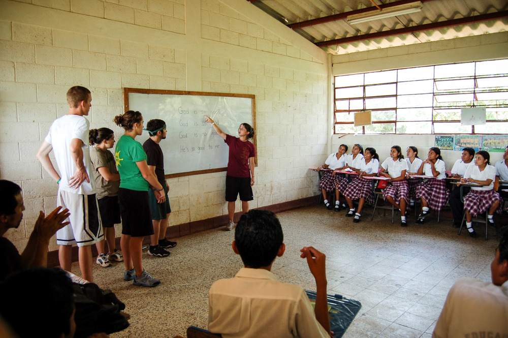 Alison (Loope) Sherrod teaches an English lesson at The Basico, a rural school in San Juan Tecuaco, Guatemala. Latin America team members spent some of their early years of ministry working in Guatemala before moving down to El Salvador to establish a hub.