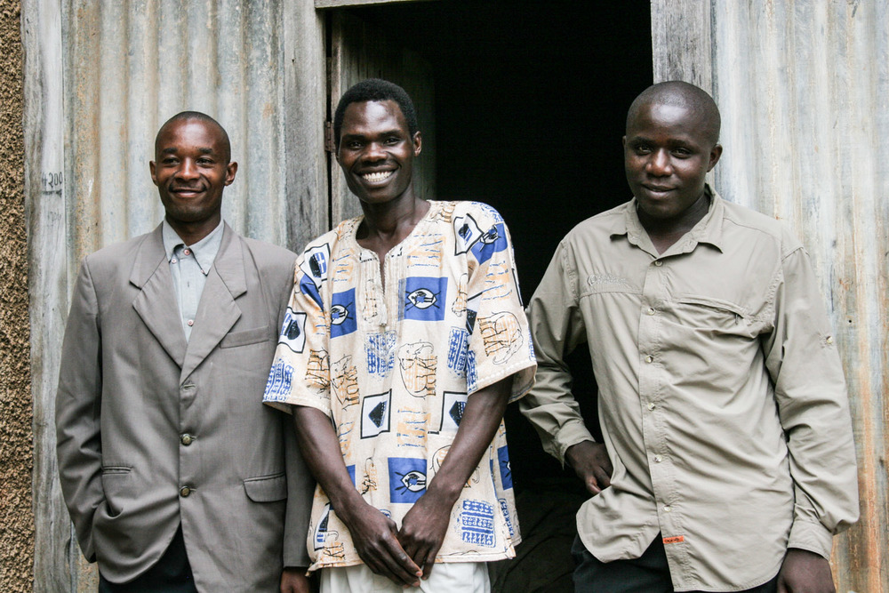 "John Gatanga, Reuben Ndwiga and Erastus Kanjogo are some of our oldest contacts from Kenya. They have partnered with us since the early 2000s, including joining us on mission to Uganda, where they stand in this picture. Gatanga reflects: ""No one else would have taken a chance on me. But with G.O.D. Int'l, I have learned the Word of God and become someone I never knew I could be."""