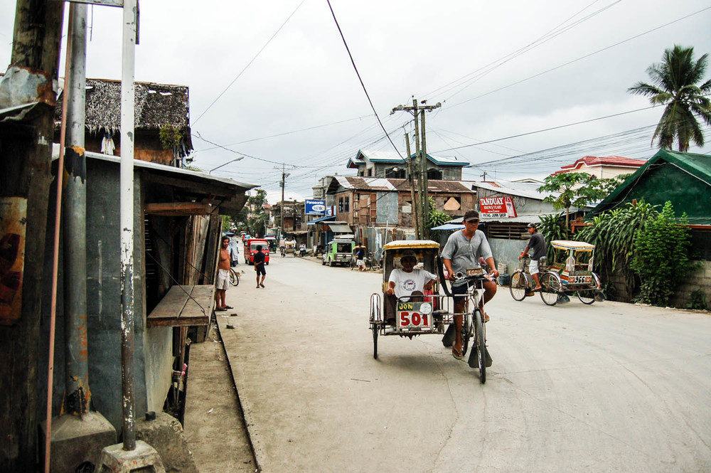 Pedicabs are a common form of transportation for those in urban areas in the Philippines.  Often times, the drivers work 12-14 hour days only to come up short of what they need to provide for their families.  But with minimal skill level required, and little overhead, it is at least some means of income for many adult men in a business industry that values the energy of youth.