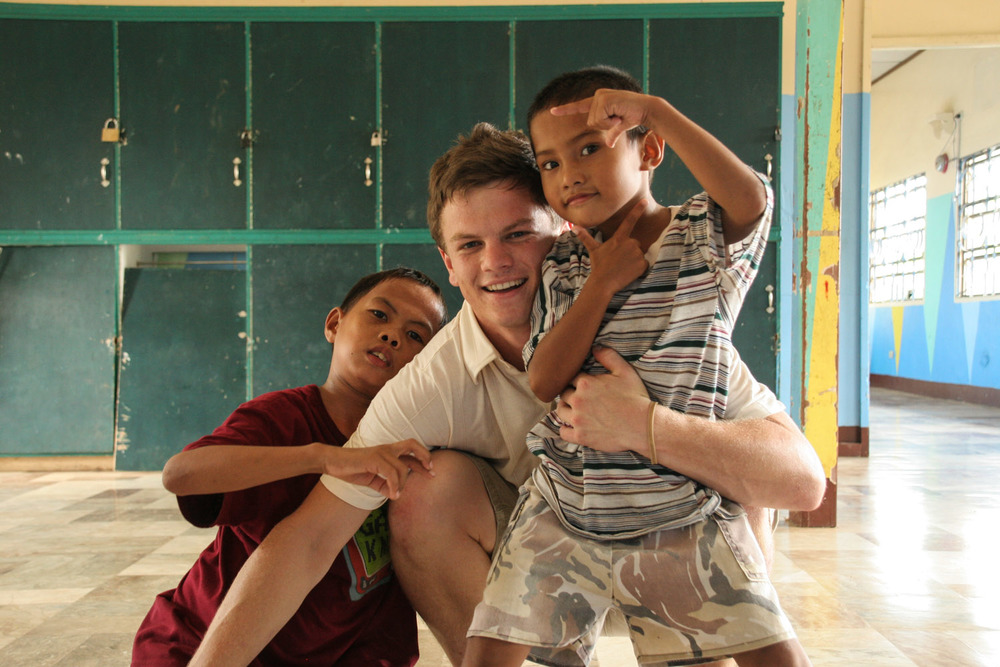 Jason Carpenter spends the afternoon playing with a couple orphan boys at a children's home on the island of Luzon.  The home often takes in boys who would otherwise have to spend time in detention facilities that do not have a reputation for rehabilitation.  At this particular facility, the boys are given a holistic opportunity for development - including classroom education, physical education, and often psychological restoration from the trauma that many of them have experienced.