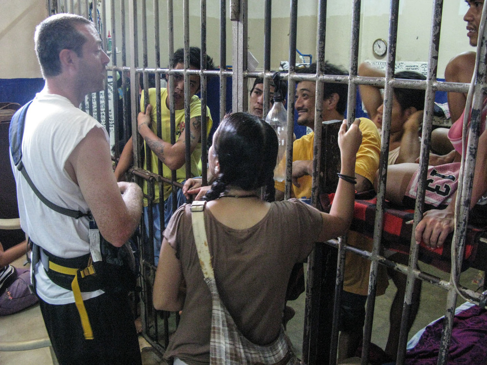 Shaun Galford preaches from a passage in Isaiah to prisoners at the Olongapo City holding cell while Rina Miller translates.  Prisoners often forgotten and ignored. The South East Asia Team is developing a holistic response to help the captive.