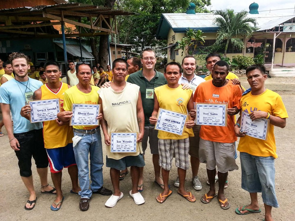 In 2013 Craig Duffy, Clark Miller, and Shaun Galford taught a 7 week Bible course at a jail in Cebu. On the last day there was a time for sharing testimony followed by a celebration. Pictured are the men holding the certificates they received for completing the course.