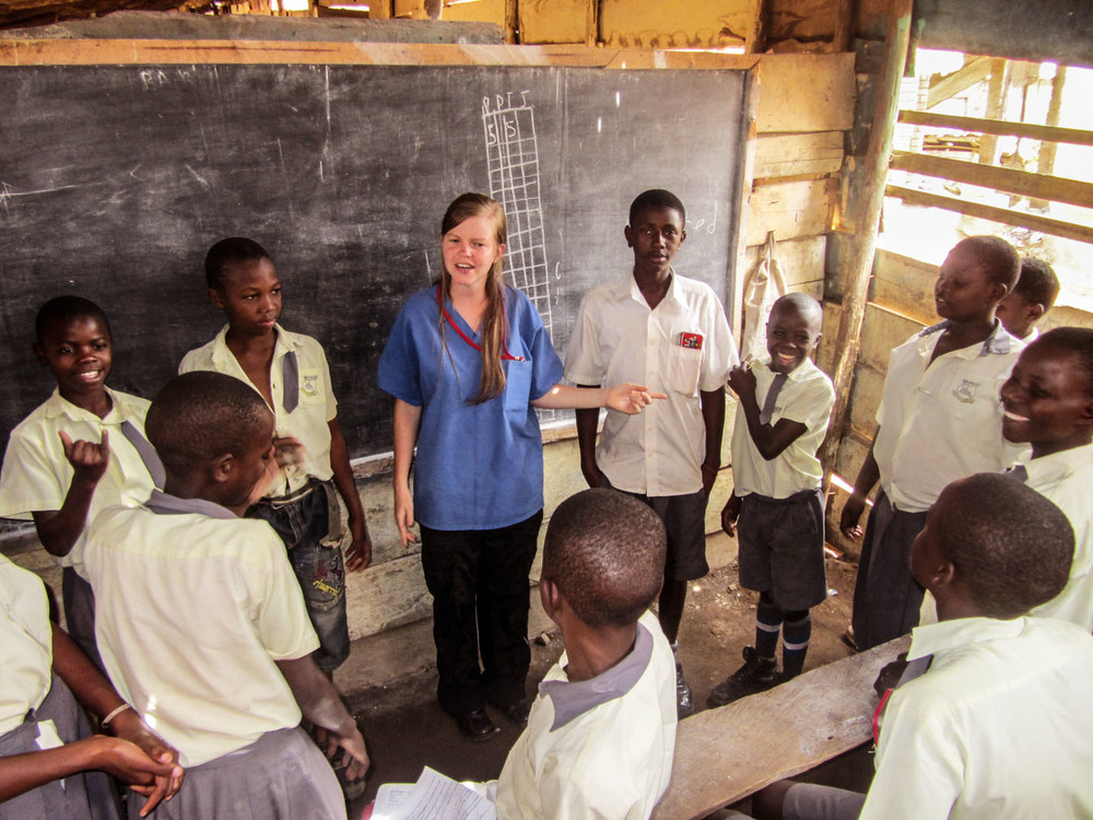 Brynn Buchanan teaches primary school students in a slum about the importance of hygiene and sanitation. Millions of people in Africa suffer and die from water and hygiene-related diseases. Instruction in simple hygienic procedures can save lives. Children are often most susceptible to spreading disease, so educating them in proper preventative measures, like hand washing, ultimately affects the well-being of entire families.