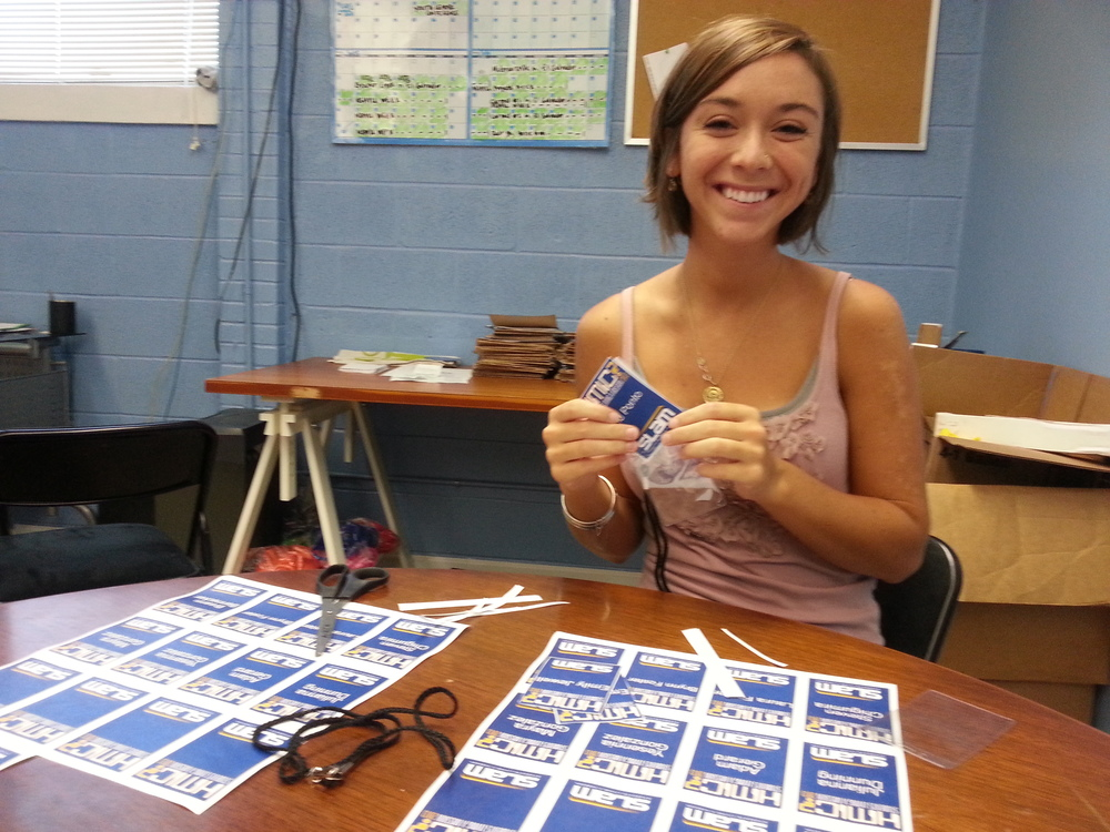 Leah Thress, a regular SLAM volunteer, makes name tags for each of the individuals participating. It's important for us to know each student by name, and for them to be easily identified when they're serving throughout Nashville.