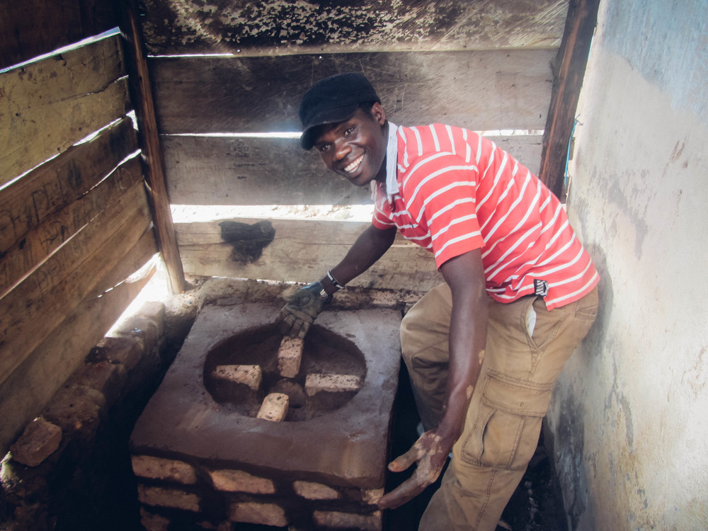 Reuben Ndwiga of Kenya earns his income as a farmer and as a builder of these innovative rocket stoves. The stove is a model he and his brother have perfected and now market to others in their community. It uses far less firewood than open air stoves, protects people from open flames, and produces far less smoke. (Uganda, 2009)
