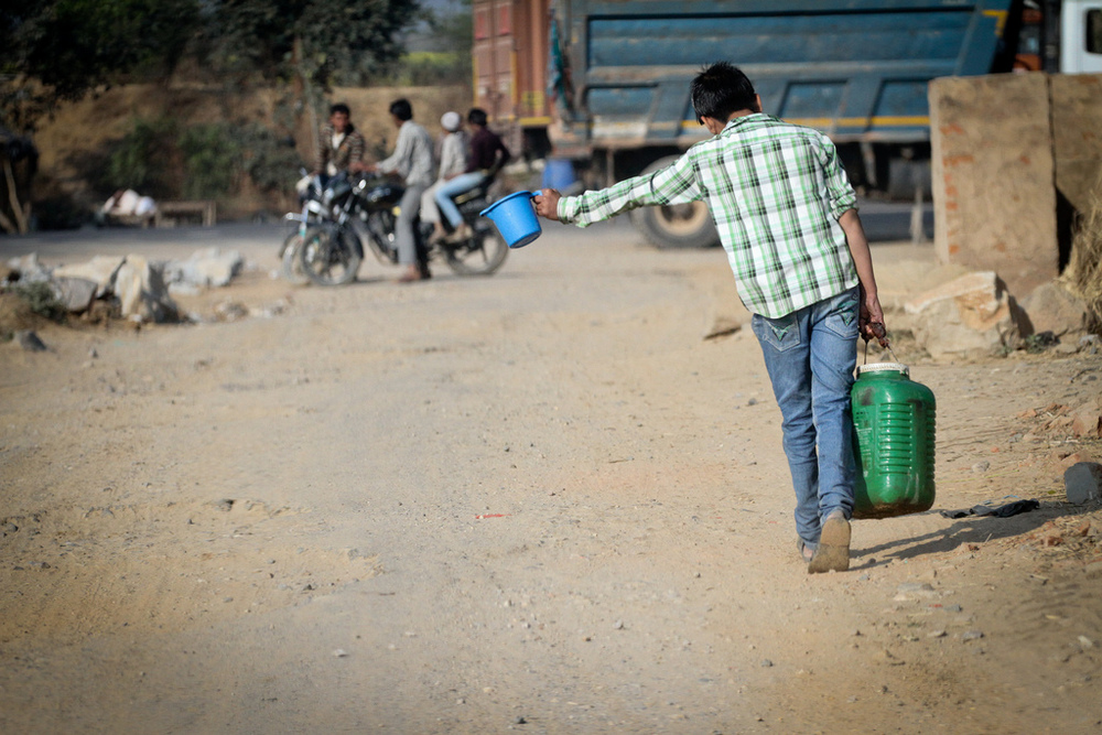 UNICEF estimates that a quarter of India's population doesn't have water on their premise. Often, the work of collecting water for the family falls on the children.  Not only does this chore inhibit children from attending school, it is also back-breaking work.  Older children and women will carry up to 45 lbs. of water at a time.