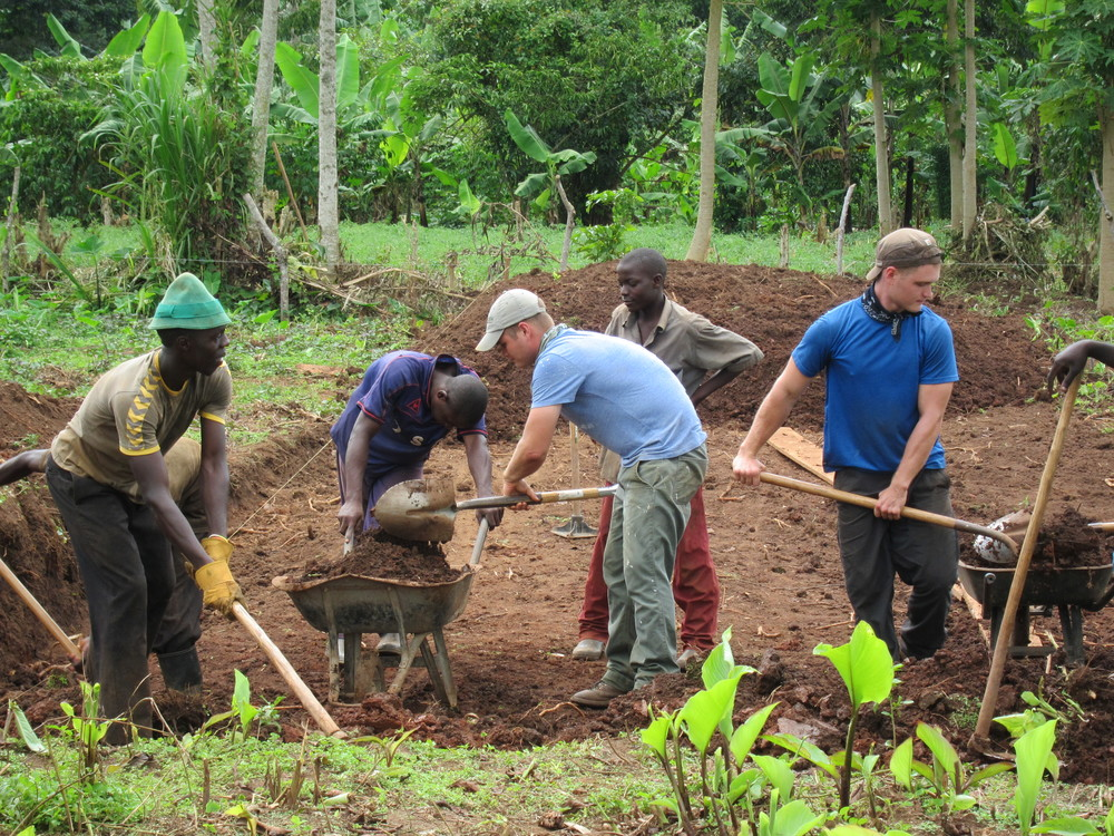 Rather than utilizing an expensive tractor, we employed multiple men to excavate our land. Providing employment and fair wages to the men of the surrounding community is a means to contribute to healthy families, while also demonstrating the power of human cooperation.