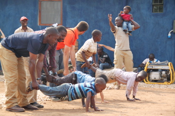 On a Sunday afternoon, fathers and sons participated in wheelbarrow races. Happy, healthy families are, to us, the best sign of lives being holistically transformed by the Word of God. Sundays in Uganda are a good time for families to gather as a community for prayer, Bible study, and fellowship.