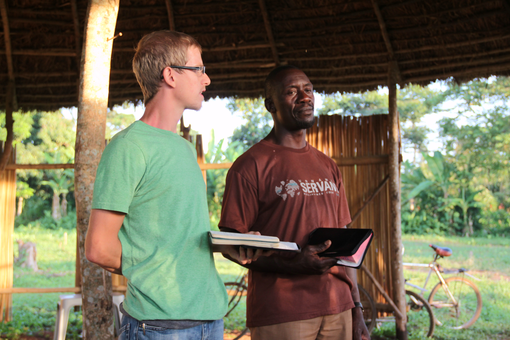 Rylan Aaseby shares from the Word at a Sunday night Bible study, while Peter Kimbugwe (East African cooperative) translates into the local Luganda language. Rylan spoke on allowing God's Word to shape our language and thoughts so that our words might benefit society, in the same way God's Word has benefitted us as persons. Sunday nights are a consistent and energizing time to share songs of worship, testimony and teaching in God's Word.