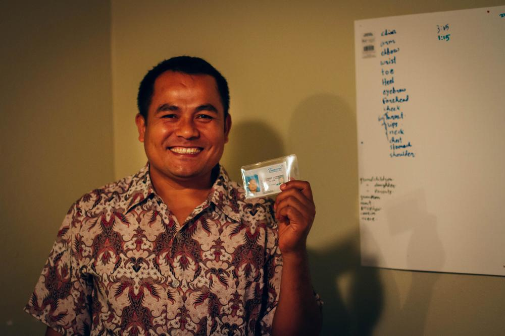 Hia Tin shows off his newly acquired driver's license. This license will make life for his family much easier, and the opportunities available to him in the U.S. much more attainable.