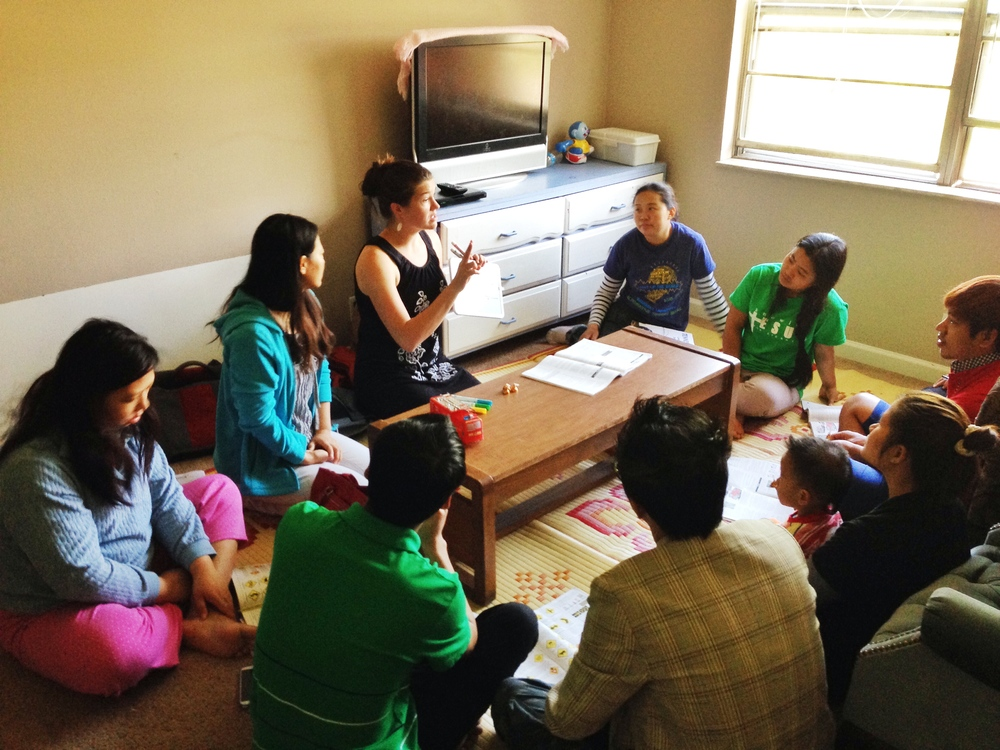 Rebekah Davis, with the help of a translator,  teaches a group of Burmese refugees the basics of driving in America. Her class grew quickly in size, due to the desperate need for this kind of education in their community.