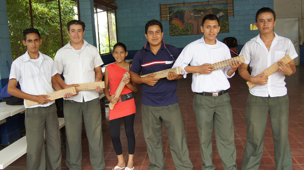 While Rafael Reyes was in El Salvador he taught music to this eager group. He helped them make their own fret boards out of wood, nails, and string, so that they could practice at home.