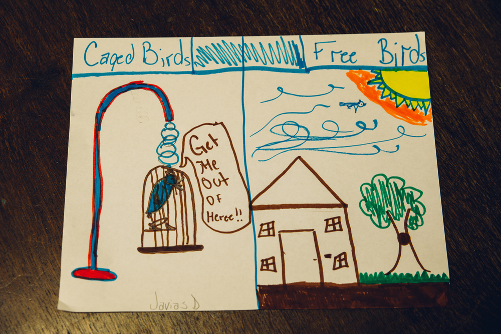 """During a literacy activity, students were encouraged to visually depict the metaphors found within the poem, """"I Know Why the Caged Bird Sings"""" by Maya Angelou."""