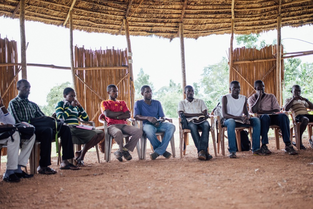Students from the Institute for G.O.D. International East Africa engage in a group discussion.