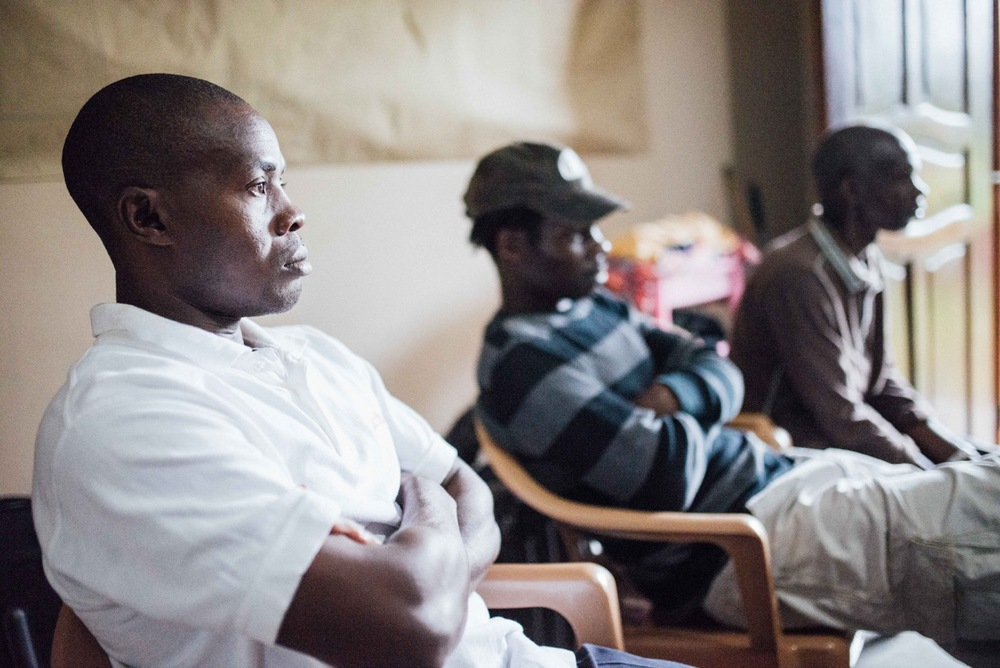 Francis Lubega, at left, sits alongside Kenyan cooperatives Reuben Ndwiga and Simon Njeru. Cross-cultural relationships between Kenya and Uganda are yet another challenge to work through in meetings like this.