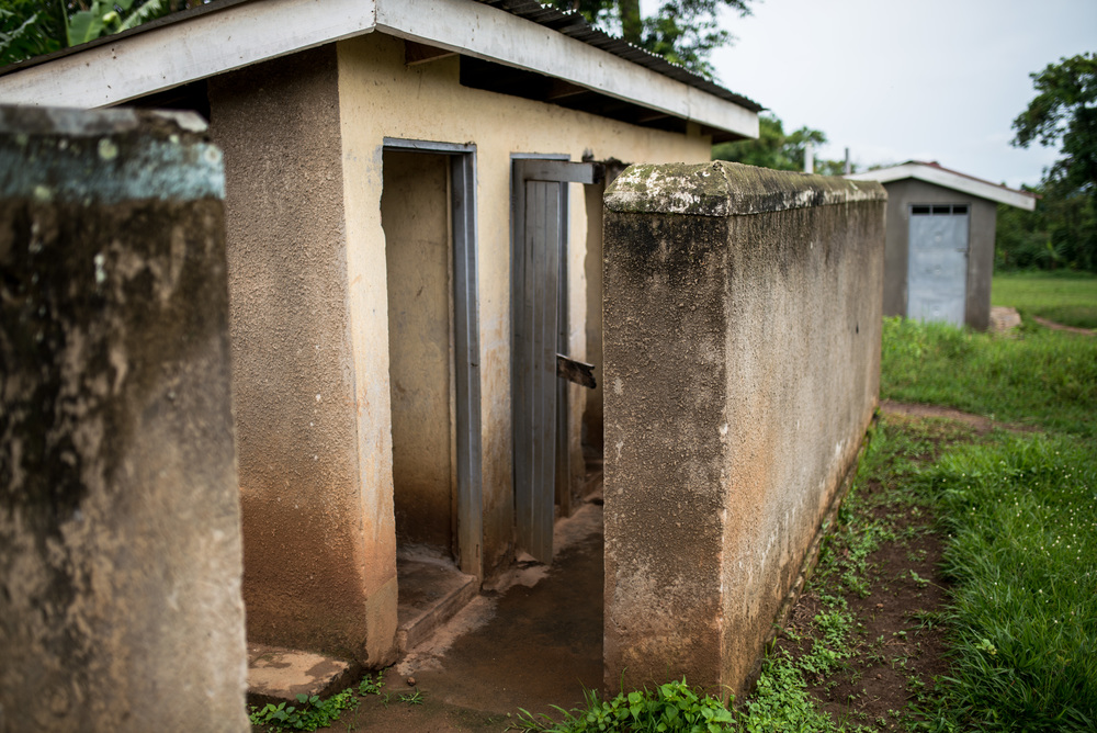 The bathrooms at St. John's. Bathrooms like this can be prohibitive to school attendance, particularly for girls. We have been supplying re-usable sanitary pads to the girls at the school, but the bathrooms still need improvement.
