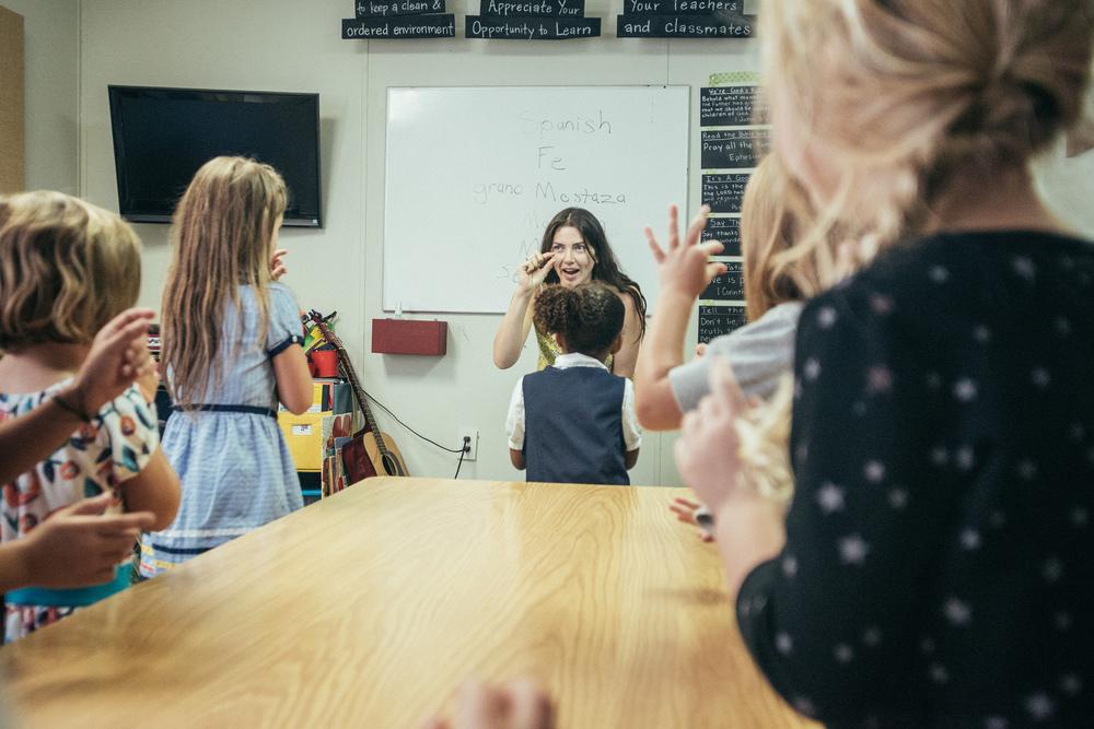 Jaimee Arroyo teaches the kindergartners songs in Spanish.